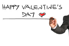 Man writing Happy Valentines day with a red heart at the end Royalty Free Stock Images