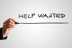 Man writing Help Wanted on a virtual screen Stock Photography