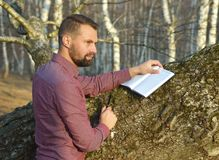 Man writing in his notebook Royalty Free Stock Images