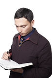 Man writing in his planner Royalty Free Stock Photos