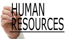Man writing Human Resources on a virtual screen. With a marker pen conceptual of employment, recruitment and manpower Stock Image