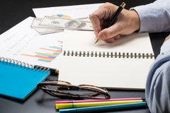 Man writing idea for Analysis Business and financial report Royalty Free Stock Image