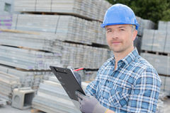 Man writing inventory report. Man writing an inventory report Royalty Free Stock Image