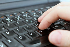 Man is writing with keyboard of laptop Royalty Free Stock Image