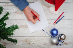 Man writing letter to Santa in Christmas situation Stock Photo