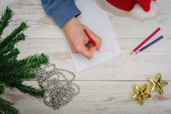 Man writing letter to Santa in Christmas situation Royalty Free Stock Images