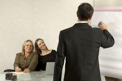 Man Writing in Meeting Royalty Free Stock Images