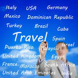 Man writing the names of travel destinations Royalty Free Stock Photo