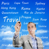 Man writing the names of travel destinations Stock Photography