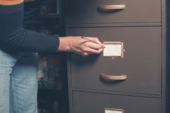 Man writing note on file cabinet Stock Photography