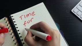 Man writing in a note Time for action. Business motivation stock video footage