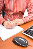 Man writing in a notebook Royalty Free Stock Photography