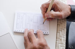 Man writing in the notebook Stock Images
