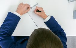 Man writing in a notebook in the office Royalty Free Stock Photo