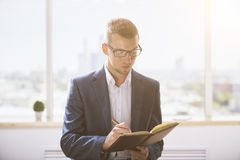 Man writing in notepad Stock Photos