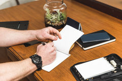 Man Writing in Notepad Royalty Free Stock Photography