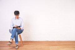 Man writing in notepad interior Royalty Free Stock Images