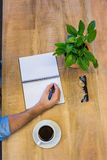 Man writing in notepad Stock Photo