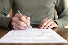 Free Man Writing On Paper With Pen On Table Stock Images - 12436034