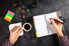 Man writing in organizer Royalty Free Stock Images