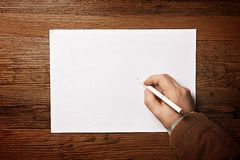 Man writing on paper Royalty Free Stock Images