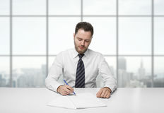 Man writing on paper Stock Photos