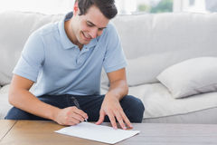 Man writing on a paper Royalty Free Stock Photography