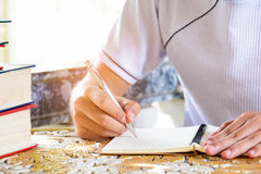 Man writing pen in book Royalty Free Stock Image