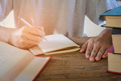 Man writing pen in book Royalty Free Stock Photo