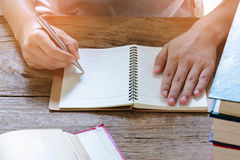 Man writing pen in book Royalty Free Stock Images