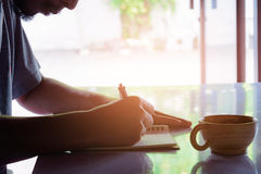 Man writing pen in book on white table Royalty Free Stock Photos