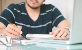 Man writing with the pen. Royalty Free Stock Photos