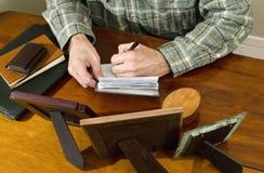 Man writing personal check Royalty Free Stock Photos