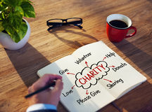 Man Writing and Planning Charity Concepts Royalty Free Stock Photo