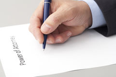 Man Writing a Power of Attorney Stock Photo