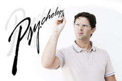 Man is writing `Psychology` Royalty Free Stock Photos