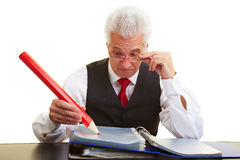 Man writing with red marker Royalty Free Stock Photo