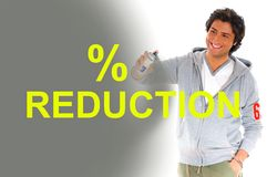 Man writing reduction prices. With sprayer Royalty Free Stock Image