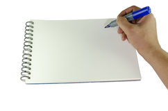 Man writing on a sketch pad with a marker pen Royalty Free Stock Photo