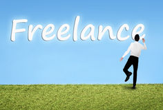 Man writing on sky Freelance word Royalty Free Stock Photos