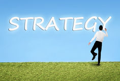Man writing on sky Strategy word Stock Photography
