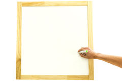 Man writing in a square wooden frame Stock Photography