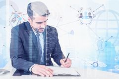 Man writing at table, digital business interface. Serious young man with beard writing at office table. Double exposure of digital business interface. Concept of royalty free illustration