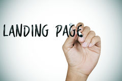 Man writing the text landing page Royalty Free Stock Photo