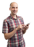 Man writing text message on smart phone Royalty Free Stock Photography