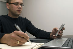 Man writing and texting stock images