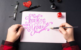 Man writing a Thank you note. Point of view of a Man writing a Thank you note Royalty Free Stock Image