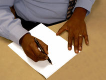 Man writing on white paper Royalty Free Stock Photos