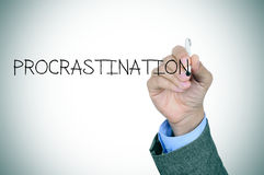 Man writing the word procrastination Royalty Free Stock Photo