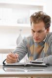 man writing young Στοκ Εικόνα